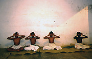 Boys practice eye exercises at dawn in a class at the Keralan Kalamandalam..The Kalamandalam was founded in 1930 to preserve the cultural traditions of Kathakali, the stylised dance drama of Kerala. Kathakali is the classical dance-drama of Kerala, South India, which dates from the 17th century and is rooted in Hindu mythology. Kathakali is a unique combination of literature, music, painting, acting and dance performed by actors wearing extensive make up and elaborate costume who perform plays which retell in dance form stories from the Hindu epics.