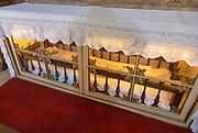 Interior of historic Roman Catholic church Igreja de Santa Maria da Devesa,  Castelo de Vide, Alto Alentejo, Portugal, southern Europe - effigy of Jesus Christ inside glass display cabinet
