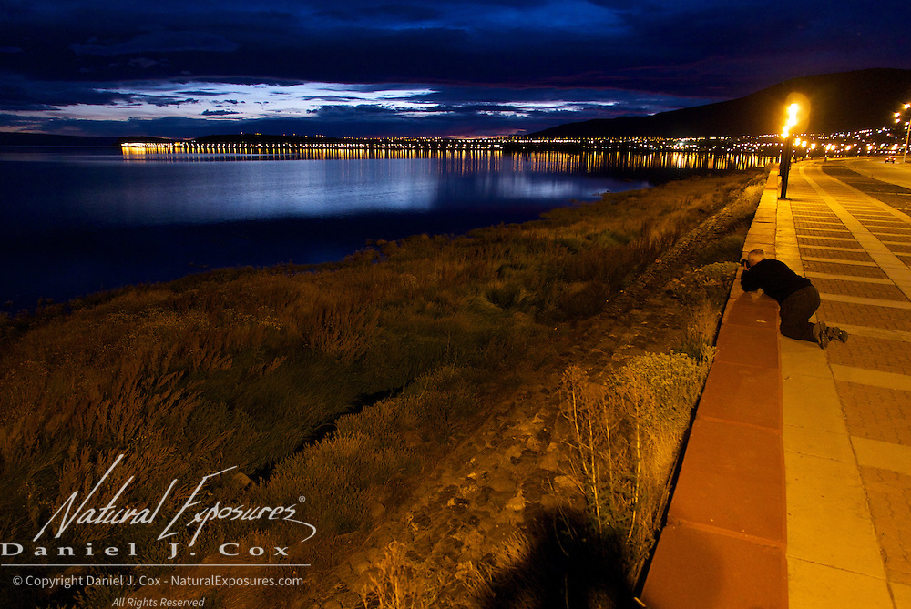 Ray takes a good position to get the shot along the waterfront in El Calafate, Patagonia Argentina