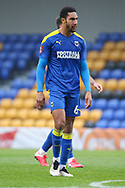 AFC Wimbledon defender Terell Thomas (6) walking off pitch during the The FA Cup match between AFC Wimbledon and Crawley Town at Plough Lane, London, United Kingdom on 29 November 2020.