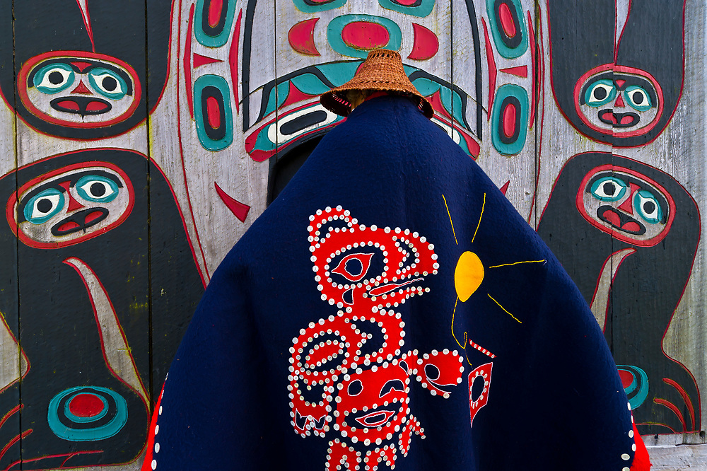Tlingit Indian tribal elder Marge Byrd in native costume with the Chief Shakes Tribal House on Chief Shakes Island, Wrangell, southeast Alaska USA
