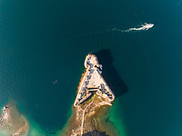 Aerial view of boat crossing near St. Nicholas Fortress during sunny day, Sibenik, Croatia.