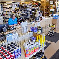 032814       Cable Hoover<br /> <br /> Carl Orr, left, and Rob Miller tend the counter at the new Poor Boys Auto Supply location on Aztec Avenue in Gallup Friday.