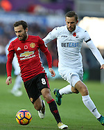 Gylfi Sigurdsson of Swansea city ® challenges Juan Mata of Manchester Utd. Premier league match, Swansea city v Manchester Utd at the Liberty Stadium in Swansea, South Wales on Sunday 6th November 2016.<br /> pic by  Andrew Orchard, Andrew Orchard sports photography.