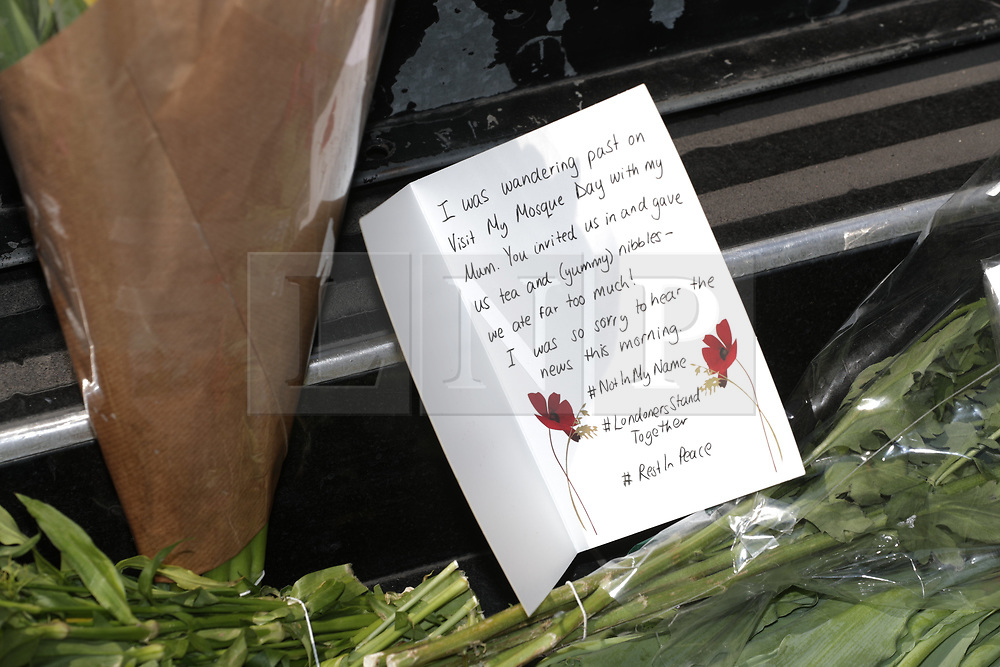 © Licensed to London News Pictures. 19/06/2017. London, UK. Flowers and tributes at the scene. One man is known to be dead and several inured after a hired van was driven in to people outside a Somalian Restaurant on Whadcoat Street in Finsbury Park in North London . Photo credit: Joel Goodman/LNP