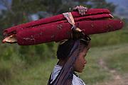 Pandanus palm fruit<br /> Dani tribe woman<br /> Budaya village<br /> Suroba<br /> Trikora Mountains<br /> West Papua<br /> Indonesia