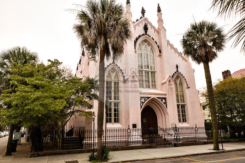 The pink French Huguenot Church in the French Quarter along Church Street in historic Charleston, SC.