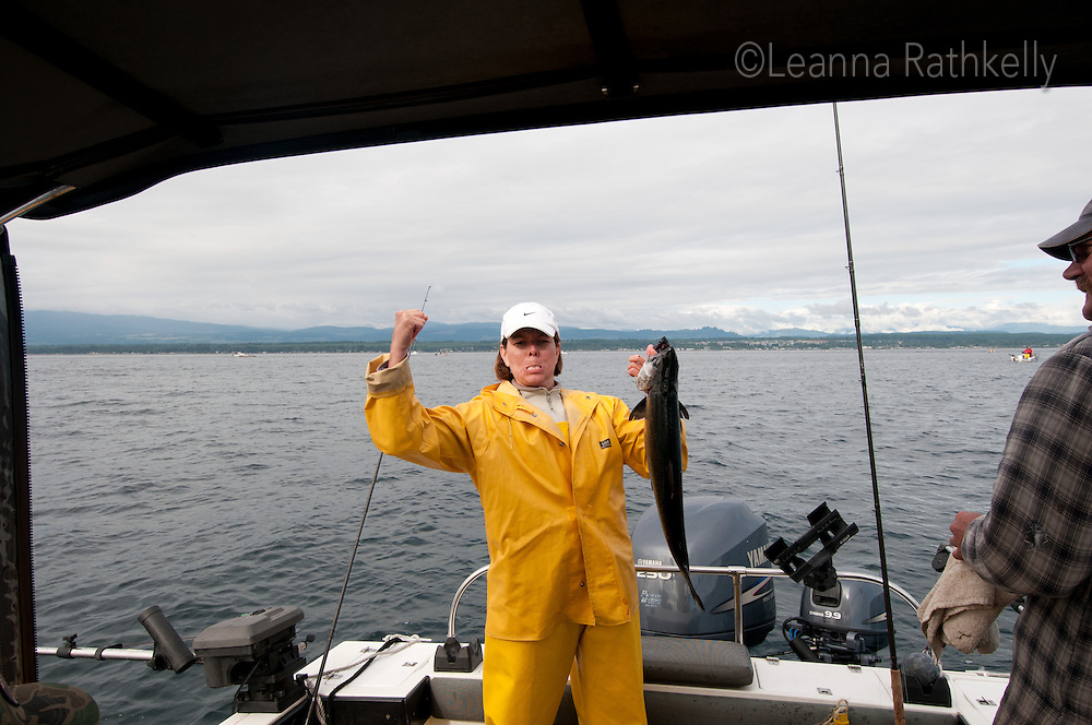 Leanna shows off the 10lb salmon after fishing off the coast of Campbell River, BC Canada