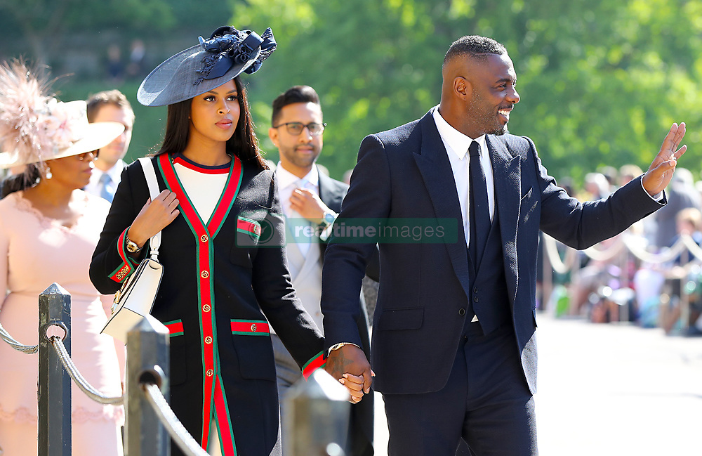Idris Elba (right) and Sabrina Dhowre arrive at St George's Chapel at Windsor Castle for the wedding of Meghan Markle and Prince Harry.
