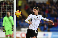 Alex Revell of Rotherham Utd tries to keep the ball in play. Skybet football league championship match, Cardiff city v Rotherham Utd at the Cardiff city stadium in Cardiff, South Wales on Saturday 6th December 2014<br /> pic by Andrew Orchard, Andrew Orchard sports photography.