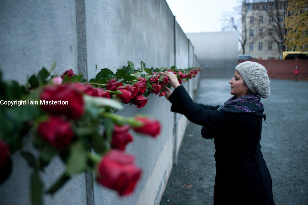 red roses paced at 20 years anniversary of fall of  Berlin Wall to commemorate victims killed during escape attempts from East Germany