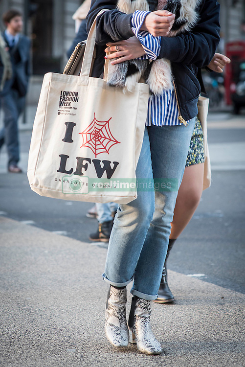 London Fashion Week tote bag during London Fashion Week Autumn/Winter 2017 in London.  Picture date: Friday 17th February 2017. Photo credit should read: DavidJensen/EMPICS Entertainment