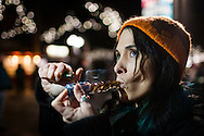 December 6, 2012. Seattle, Washington. Washington and Colorado became the first states to vote to decriminalize and regulate the possession of an ounce or less of marijuana by adults over 21. Pictured at a 'Stash Mob' gathering in Seattle is Amberlynn Ellis, smoking marijuana in public...Photo © John Chapple / www.JohnChapple.com
