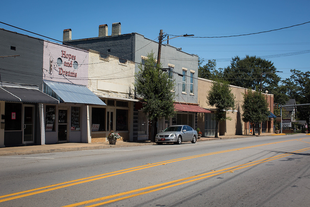 Buildings for sale or lease line the downtown strip in Bowdon, Ga. Bowdon Municipal Court Judge Richard Diment recently came under fire after a cell phone video surfaced where he was threatening defendants who were appearing in Bowdon Municipal Court with jail time if they were unable to pay fines. This photo was taken on Monday, Sept. 14, 2015. Photo by Kevin D. Liles for The New York Times