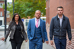 © Licensed to London News Pictures. 21/10/2019. Leeds UK. Left to right Kelly Meadows, Phillip Hoban & Jordan McDonald arrive at Leeds Crown Court this morning. 5 members of Leeds based paedophile hunting group Predator Exposure are appearing at Leeds Crown Court today. Phillip Hoban, Jordan McDonald, Jordan Plain, Dean Walls and Kelly Meadows are all accused of false imprisonment of a man in Chapel Allerton, Leeds. Hoban, 44, McDonald, 18, Plain, 25, and Walls, 51, also denied assaulting same man on same date, Hoban, Meadows,39, and McDonald denied further charge of false imprisonment of another man in Ackton, near Pontefract.Photo credit: Andrew McCaren/LNP