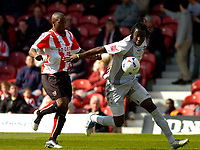 Photo: Alan Crowhurst.<br />Brentford v Bradford City. Coca Cola League 1. 08/04/2006. Bradford's Damion Stewart (R) with Isaiah Rankin challenge for the ball.