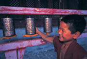 Monk turning prayer wheel<br /> Amarbayasgalant<br /> Central Mongolia