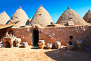 """Pictures of the beehive adobe buildings of Harran, south west Anatolia, Turkey.  Harran was a major ancient city in Upper Mesopotamia whose site is near the modern village of Altınbaşak, Turkey, 24 miles (44 kilometers) southeast of Şanlıurfa. The location is in a district of Şanlıurfa Province that is also named """"Harran"""". Harran is famous for its traditional 'beehive' adobe houses, constructed entirely without wood. The design of these makes them cool inside. 18 .<br /> <br /> If you prefer to buy from our ALAMY PHOTO LIBRARY  Collection visit : https://www.alamy.com/portfolio/paul-williams-funkystock/harran.html<br /> <br /> Visit our TURKEY PHOTO COLLECTIONS for more photos to download or buy as wall art prints https://funkystock.photoshelter.com/gallery-collection/3f-Pictures-of-Turkey-Turkey-Photos-Images-Fotos/C0000U.hJWkZxAbg ."""