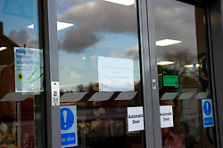 A sign in a Tesco Express outlet reads 'sorry this store will close at 10pm'  taken during the Corona Virus Pandemic of 2020<br /> <br /> Ben Booth | 20/03/2020
