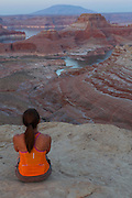 A visitor at Alstrom Point, Lake Powell, Glen Canyon National Recreation Area, Page, Arizona.  (model released)