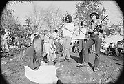 3 musicians, including Barry 'Plunker' Adams playing a Chinese erhu like a guitar on right. The Lost & Found stand is extreme right. Renaissance Faire, the  first Oregon Country Fair, November 1&2, 1969