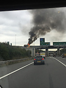"A lorry engulfed in fire on the A2 has blocked the Dartford Crossing<br /> <br /> A lorry fire blocked the Dartford Crossing this morning.<br /> <br /> The heavy goods vehicle caught alight just after 10am on the A2 slip road to the M25.<br /> <br /> A spokesman from Kent Fire and Rescue said: ""We were called at 10.22am to reports that a 32-tonne lorry had caught fire between the cab and lorry of the vehicle.<br /> <br /> ""It was on the fast flyover between the A2 and the M25 anti-clockwise.<br /> <br /> ""The lorry contained loose tarmac and we used two hose reels of foam to mask the fire.<br /> <br /> ""We extinguished it and the vehicle was 20 per cent destroyed by fire.<br /> <br /> ""There were no reports of any injuries.""<br /> Kent Police Dartford also tweeted saying their officers were at the scene assisting the fire service.<br /> <br /> There is queuing traffic London-bound at the Darenth Interchange and congestion up to the Northfleet turn off.<br /> <br /> Traffic can still join the M25 from the A2 roundabout, but there is congestion up to Bluewater on the A2.<br /> ©Sharon Hope/Exclusivepix Media"