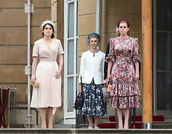 Princess Eugenie, the Duchess of Gloucester and Princess Beatrice during a Royal Garden Party at Buckingham Palace in London.