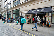 """Delivery drivers said that this is the 2nd day they are finding themselves to be free in the middle of the day as people are now allowed to come out and sit, drinking and eating, outside cafes and pubs in Soho, central London, on Tuesday, April 13, 2021. Some of England's coronavirus lockdown restrictions were eased by the British government on Monday, April 12, 2021. People across England can get their hair cut, eat and drink outside at restaurants and browse for clothes, books and other """"non-essential"""" items as shops and gyms reopened Monday after months of lockdown. (Photo/ Vudi Xhymshiti)"""