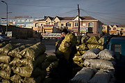 A man stacks bags of coal to be sold to residents of the capital Ulaanbaatar, in a coal market of the city, January 15, 2019. The city has among the world's highest peaks of PM2.5 – the ultra fines particles that can carry harmful carcinogens. According to the World Health Organisation (WHO), 9 out f 10 people globally breathe air containing high levels of pollutants.