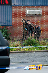 South Yorkshire Police search team and and Detectives investigate the scene of Tuesdays shooting on Cuthbert Bank Road close to Bamford street tram station <br /> <br /> 23 October 2012<br /> Image © Paul David Drabble