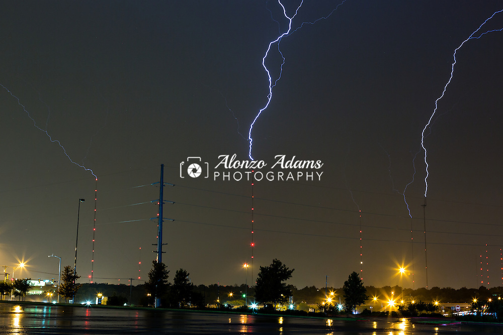 Multiple lightning bolts strike television and communication towers in Oklahoma City on Oct. 10, 2014. (Photo copyright © 2014 Alonzo J. Adams)