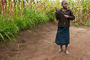 Rwanda February 2014. Bisesero. Child with home-made hoop.