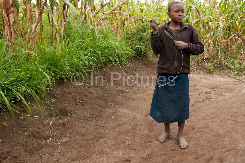 Rwanda February 2014. Bisesero. Child with home-made hoop.