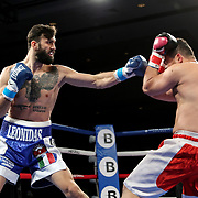 Giovanni Scuderi punches Yhago Gonclaves during a One For All Promotions boxing event at the Caribe Royale Orlando Events Center on Saturday, February 20, 2021 in Orlando, Florida. (Alex Menendez via AP)