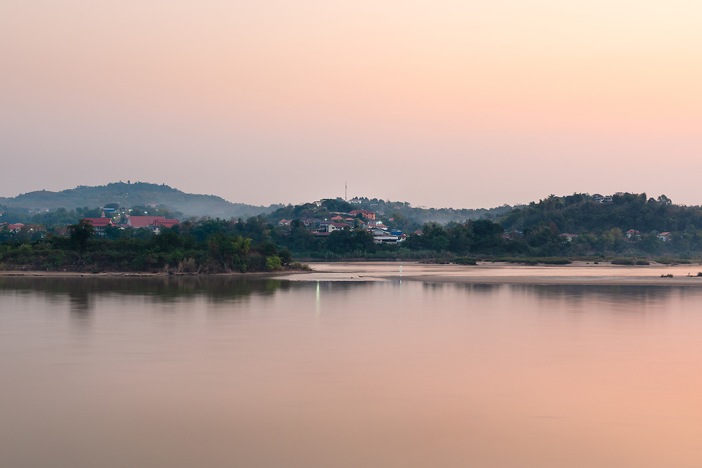 Sunrise over a small town on the Mekhong River