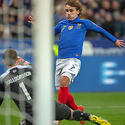 PARIS, FRANCE - March 25:  Antoine Griezmann #7 of France scores his sides fourth goal as he chips the ball over goalkeeper Hannes Por Halldorsson #1 of Iceland during the France V Iceland, 2020 European Championship Qualifying, Group Stage at  Stade de France on March 25th 2019 in Paris, France (Photo by Tim Clayton/Corbis via Getty Images)