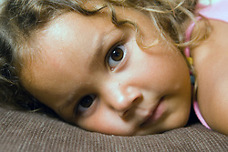 Young girl lying on the sofa,