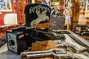 """Boots and pistols used by Roy Rogers. Roy Rogers (born Leonard Franklin Slye in 1911, died in 1998) was an American singer and cowboy actor who was one of the most popular Western stars of his era. Known as the """"King of the Cowboys"""", he appeared in over 100 films and numerous radio and television episodes of The Roy Rogers Show. He often appeared with his wife Dale Evans, his golden palomino Trigger, and his German Shepherd dog Bullet. His show ran on radio for nine years before moving to television from 1951 through 1957. His productions usually featured a sidekick, often Pat Brady, Andy Devine, or George """"Gabby"""" Hayes. In his later years, Rogers lent his name to the Roy Rogers Restaurants franchise chain. Fans of movies and television shouldn't miss the Museum of Western Film History, 701 S. Main Street, Lone Pine, California, 93545, USA. (Formerly called the Beverly and Jim Rogers Museum of Lone Pine Film History.) Web site: www.lonepinefilmhistorymuseum.org"""