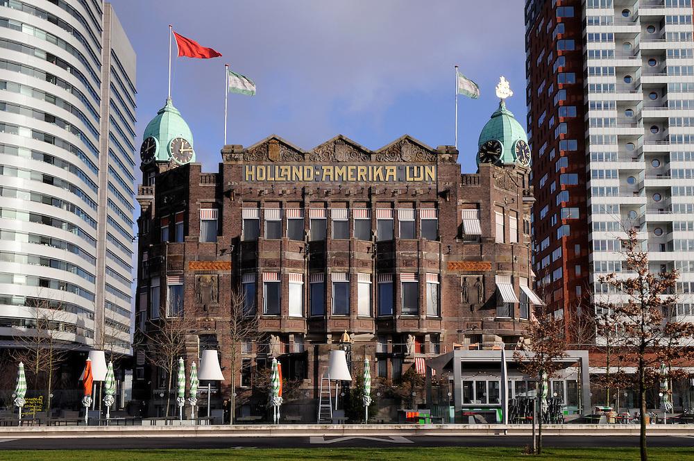 Die Holland-America Line (HAL), bekannt geworden als Holland-Amerika Lijn, ist die Premium-Marke der Carnival Corporation & plc mit Firmensitz in Seattle, Washington.<br /> <br /> Die ursprünglich niederländische Reederei betrieb von Rotterdam über 100 Jahre einen erfolgreichen transatlantischen Passagier-Liniendienst und hatte mehrere Jahrzehnte quasi ein Monopol für die Auswanderung aus den Niederlanden in die USA. Insgesamt wanderten so über eine Million Menschen mit der Holland-Amerika Lijn aus. Bis 1973 betrieb das Unternehmen weltweit Frachtschiffe.<br /> <br /> Wegen zunehmender Konkurrenz durch Fluggesellschaften verlegte sich das Unternehmen ab 1971 auf Kreuzfahrten. 1988 geriet die HAL durch Übernahme der Windstar Sail Cruises in finanzielle Schwierigkeiten und wurde schließlich selbst von der direkten Konkurrenz aufgekauft. Heute fahren 13 Schiffe unter dem Logo der HAL und transportieren pro Jahr etwa 700.000 Passagiere.<br /> <br /> Rotterdam, das heute noch Europasitz des Unternehmens ist, ist im Stadtbild stark von der HAL geprägt. Das ehemalige Hauptquartier ist als Hotel New York eine feste Größe im Hafengebiet, ebenso wie das Kreuzfahrtterminal. Das ehrgeizige Stadterneuerungsprojekt Kop van Zuid baut in seiner Ikonografie maßgeblich auf der Amerika-Auswanderung aus.<br /> <br />  |  Building and European Headquarter of the Holland America Line is a British-American owned cruise line based in Seattle. It has been owned by Carnival Corporation & plc since 1989.<br /> <br /> From 1873 to 1989, it was a Dutch shipping line, a passenger line, a cargo line and a cruise line operating primarily between the Netherlands and North America. As part of this rich legacy, it was instrumental in the transport of many hundreds of thousands of immigrants from the Netherlands to North America.   |