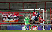 Football - 2020 / 2021 Sky Bet League Two - Morecambe vs. Bradford City<br /> <br /> Andy Cook of Bradford City rises above Stephen Hendrie and Nat Knight-Percival of Morecambe to get his header in from a corner, at the Mazuma Stadium.<br /> <br /> COLORSPORT/ALAN MARTIN
