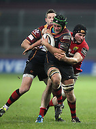 Nic Cudd of the Newport Gwent Dragons is held back by Tommy O'Donnell of Munster.<br /> Guinness Pro12 rugby match, Munster v Newport Gwent Dragons at Thomond Park in Limerick , Ireland on Saturday 5th March 2016.<br /> pic by  John Halas, Andrew Orchard sports photography.