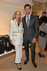 OLIVIA PALERMO and JOHANNES HUEBL at the launch of the new Rimowa store at 153a New Bond Street, London on 29th June 2016.
