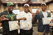 Lamar's Ira Savage-Lewis (Baylor), left, Braylon Hyder (SMU), center, and Celious Barner (HBU) show their school signs during a National Signing Day ceremony at the Region 4 Education Center, February 5, 2014.