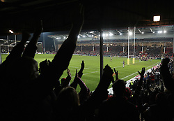 Gloucester fans in The Shed celebrate as Gloucester score their third try during the Aviva Premiership match at the Kingsholm Stadium, Gloucester.