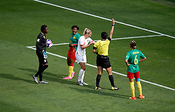 Match referee Qin Liang (second right) awards a free-kick to England in the penalty area after a back pass by Cameroon's Augustine Ejangue (second left) during the FIFA Women's World Cup, round of Sixteen match at State du Hainaut, Valenciennes.