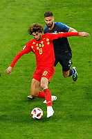 SAINT PETERSBURG, RUSSIA - JULY 10: Marouane Fellaini (in front) of Belgium national team and Olivier Giroud of France national team vie for the ball during the 2018 FIFA World Cup Russia Semi Final match between France and Belgium at Saint Petersburg Stadium on July 10, 2018 in Saint Petersburg, Russia. MB Media