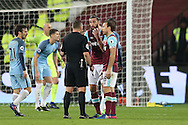 Andy Carroll of West Ham United  and Mark Noble, West Ham United captain arguing with Referee Kevin Friend. Premier league match, West Ham Utd v Manchester city at the London Stadium, Queen Elizabeth Olympic Park in London on Wednesday 1st February 2017.<br /> pic by John Patrick Fletcher, Andrew Orchard sports photography.