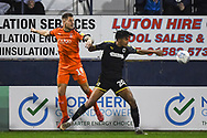 AFC Wimbledon Defender Toby Sibbick (20) and Luton Town Forward James Collins (19) in action during the EFL Sky Bet League 1 match between Luton Town and AFC Wimbledon at Kenilworth Road, Luton, England on 23 April 2019.
