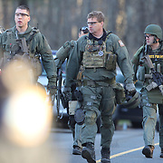 Armed police near the fire station in Sandy Hook after today's shootings at Sandy Hook Elementary School, Newtown, Connecticut, USA. 14th December 2012. Photo Tim Clayton