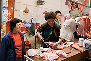 Fresh meat on sale in butcher shop in old Chinese Soho food market in Graham Street, Hong Kong, China